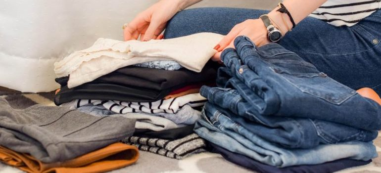 A woman folding clothes